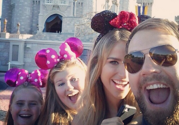 The couple with Brian's girls in Disneyland