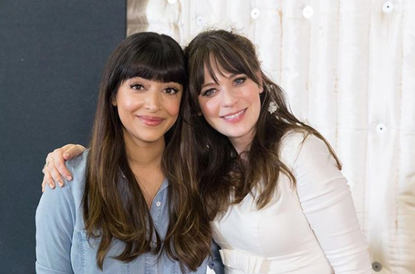 Hannah Simone with her New Girl co-star Zooey Deschanel